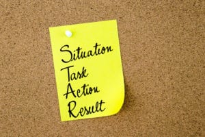 Post It Note with Situation, Task, Action & Result written on it
